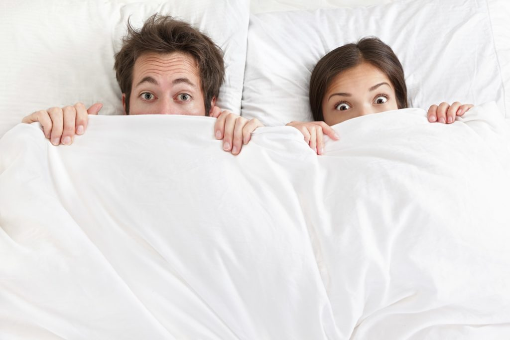 Funny couple in bed